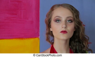 Portrait of mysterious girl with creative make-up and...