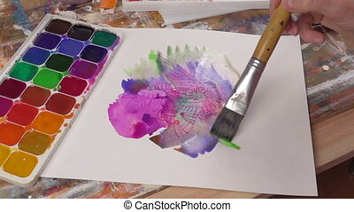 Closeup of paintbrush on the picture