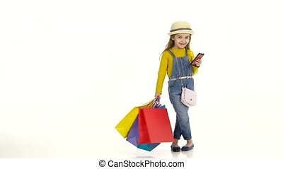 Girl in a hat with package holding phone and pishit posts....