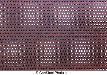 perforated metal rusty surface background