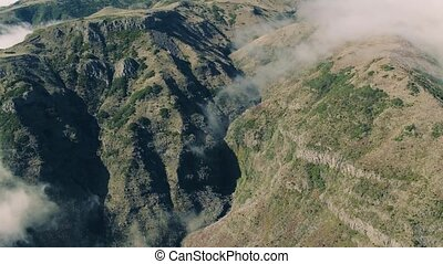 Aerial View of the Canyon and Mountains with Clouds, Island...