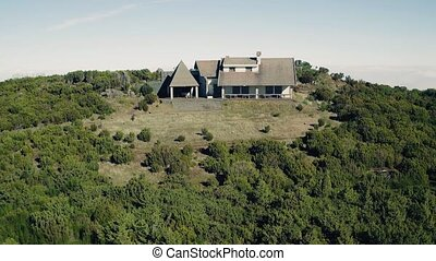 Aerial View of the Abandoned House on Top Mountain Above...