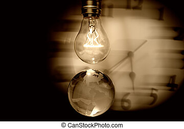 Light bulb, earth and clock, concept of global issues