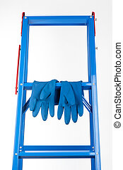 blue rubber glove - dry blue rubber glove hanging on ladder,...