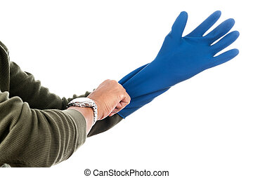 blue rubber glove - The man wearing blue rubber glove to...