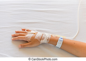 Saline intravenous drip on children hand