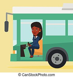 African bus driver sitting at steering wheel.