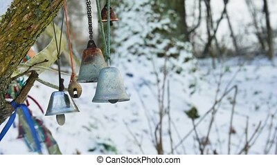 Bells in a winter forest blowing gently in the wind.