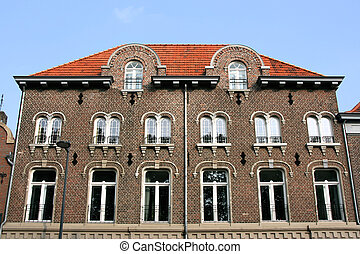 Holland - Old brick residential building in Roermond,...