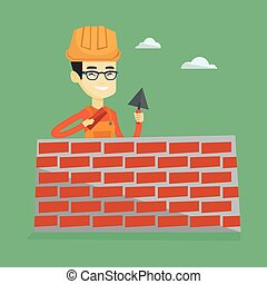 Bricklayer working with spatula and brick. - Asian...