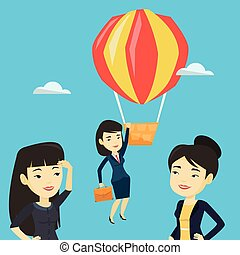 Business woman hanging on balloon. - Two young asian...