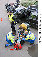 First aid team of paramedics, firefighter and police...