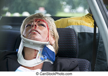 neck brace - woman with a neck brace to support her spinal...