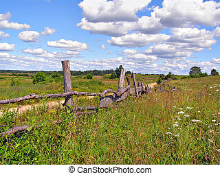 old fence on field near roads