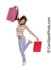 Woman jumping with shopping bags over white background