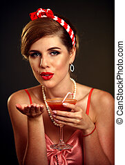Kiss blow of pin up girl drink bloody Mary cocktail . Pin-up...