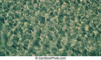 Aerial View Takeoff from Surface Ocean with Small Waves,...