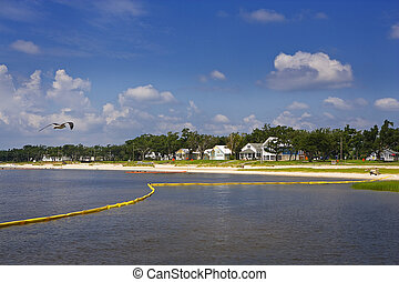 Yellow Boom & Bay, Gulf Coast - A yellow boom protects a...
