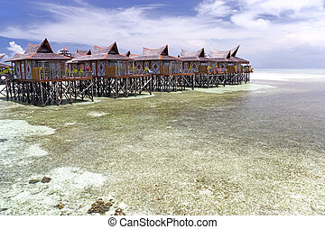 Tropical Island Huts on Stilts - Image of huts on stilts on...