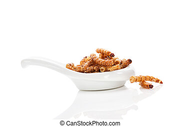 Fried worms. - Fried bamboo worms on white spoon isolated on...