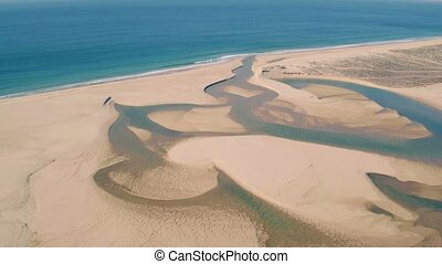 Aerial View Above Ocean Beach with Lagoon, Portugal