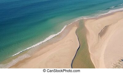 Aerial View Above Ocean Beach with Channel, Portugal