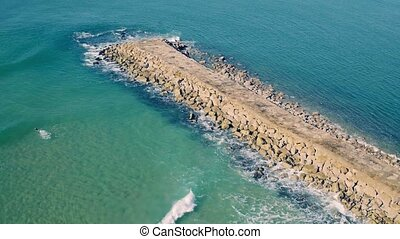 Aerial View Above Ocean Beach with Breakwater, Portugal