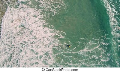 Aerial View of Surfers Riding Green Ocean Waves, Portugal