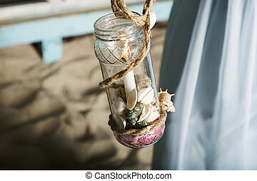 A candle in a jar.
