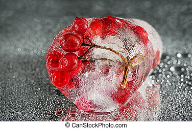 Berries frozen in water on a silver background