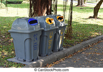 Gray recycle bin, trash bin in the park