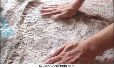 Girl lathers procurement of wool during felting, close up