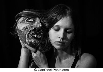 Girl with a theatrical mask in his hands
