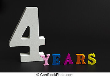 Four years. - Figures and year on a black background.