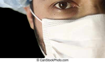 Macro close-up of human eye. A man in a medical mask and...
