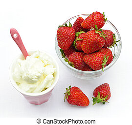 Bowl of strawberries with whipped cream - Bowl of fresh...