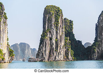 Rock islands near floating village in Halong Bay, Vietnam.