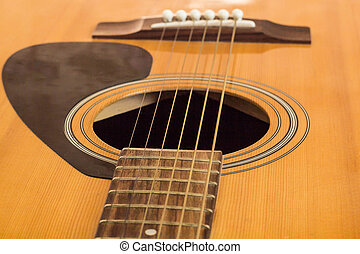 detail of classic guitar with shallow depth field