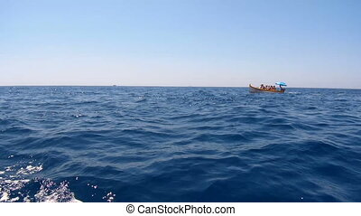 Boat moving in the sea splashing water. - Sightseeing boat...