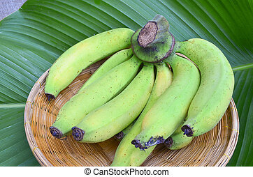 Bunch of bananas on leaf background - Bunch of bananas on...