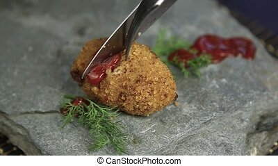 Homemade meat cutlets in batter with parsley, ketchup and...