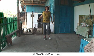 the young woman turns Hoop on waist - beautiful woman with a...