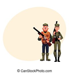 Two typical hunters, male and female, standing with rifles