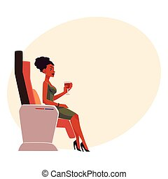 Black, African lady, woman drinking wine in airplane business class