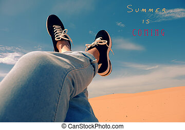 summer is coming, woman foot on sand hill - Summertime...