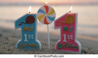 One year old birthday candle for twins - Close-up shot of...