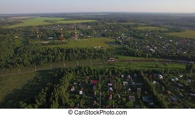 Summer houses in the countryside and freight train, aerial...