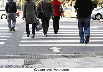 Crosswalkers - Cross walkers on a busy highway rush hour at...