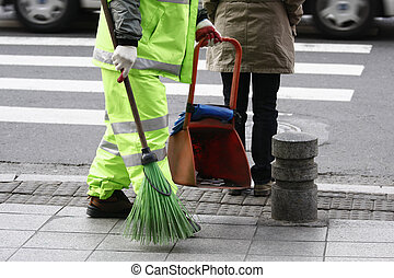 street cleaner sweeping the road with a broom in Seoul Korea