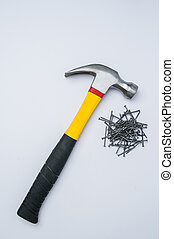 Hammer and metal nails on a white background - Hammer with...
